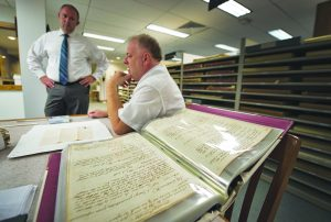 Gary Clemens, Clerk of the Loudoun County Circuit Court and Archivist Eric Larson during an interview with Loudoun Now about about their efforts to create an online database from the centuries of records they have on hand. [Douglas Graham/Loudoun Now]