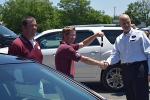 Chris Van Vlack accepts the keys to his new car from Star Buick General Sales Manager Pat Martin.