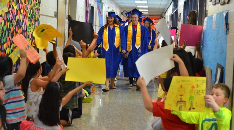 Members of Park View High School's class of 2016 were treated like celebrities when they visited Sterling Elementary School Wednesday. (Danielle Nadler/Loudoun Now)