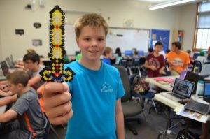 Logan McNabb, 11, shows off a sword he created in the Minecraft/Mindcraft camp offered by Loudoun Country Day School. (Danielle Nadler/Loudoun Now)