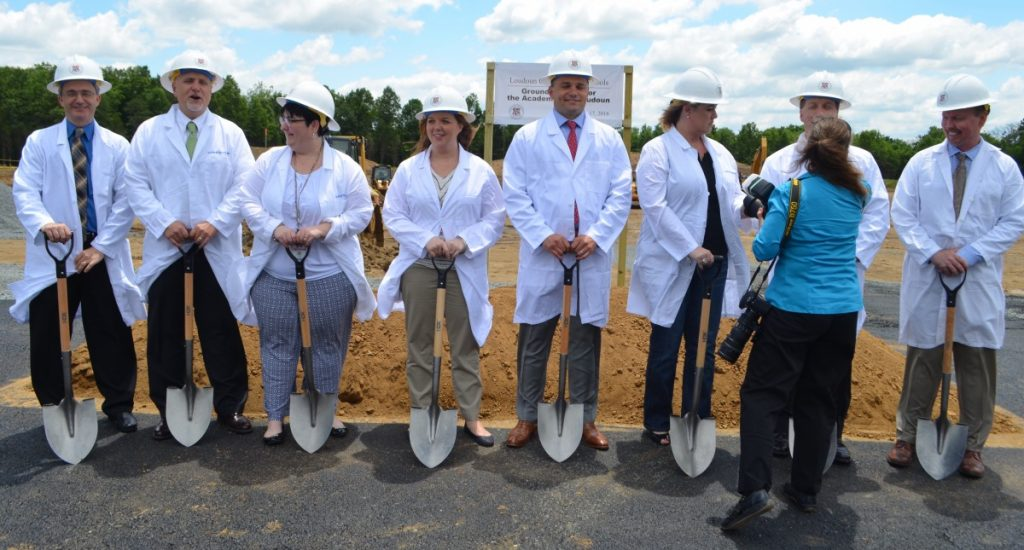A photographer positions members of the Loudoun County School Board at the Academies of Loudoun groundbreaking ceremony. (Danielle Nadler/Loudoun Now)