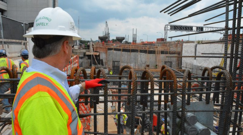 Keith Couch, senior vice president of Clark Construction, looks over work at the Dulles Airport metro station.