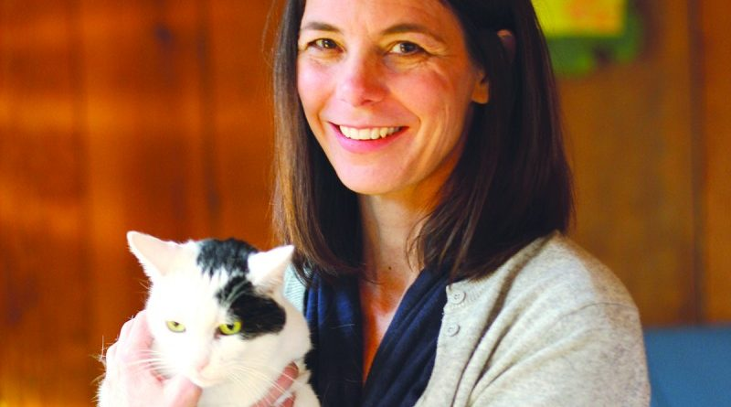 Loudoun author Heather Green with her cat, Oona, who inspired her new memoir.  [Courtesy of Berkley Publishing]