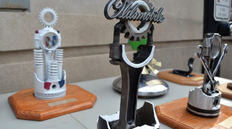 Trophies made by C.S. Monroe Technology Center students were handed out to the owners of the top-rated cars.  (Danielle Nadler/Loudoun Now)