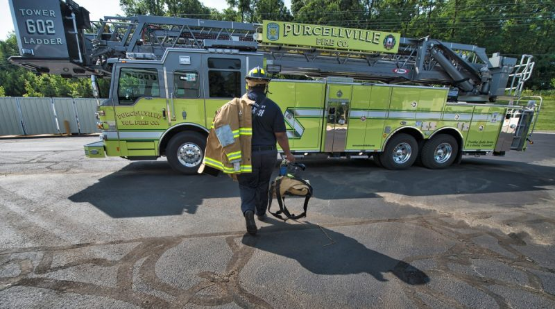 Firefighter Black hauls his gear out to Tower Truck 602 of the Purcellville Public Safety Center in Purcellville, Virginia. (Douglas Graham/Loudoun Now)
