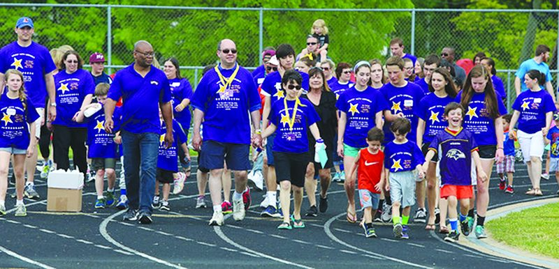 More than 200 people participated in the Smashing Walnuts Walk-a-Thon last year. The event, now called the Smashing Walnuts Walk and Fitness Challenge, is scheduled for Sunday and expected to draw an even larger crowd.