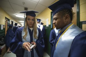 Graduating seniors Madelyn Ashwill and Jackson Brown get ready for the Stone Bridge High School commencement ceremony. (Photo by Douglas Graham/Loudoun Now)