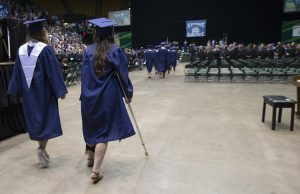 Graduating seniors make their way to their seats during the processional of the Stone Bridge High School commencement exercises. (Photo by Douglas Graham/Loudoun Now)