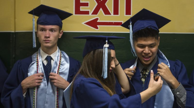 Graduating seniors Eric Bailey, Maya Aychan and Donoven Aviado snap a quick selfie before the start of the Stone Bridge High School commencement exercises. (Photo by Douglas Graham/Loudoun Now)