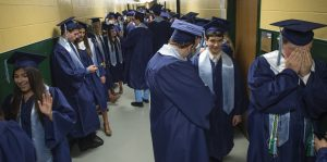 Graduating seniors show the full gamut of human emotions as they get ready before the start of the Stone Bridge High School commencement ceremony. (Photo by Douglas Graham/Loudoun Now)