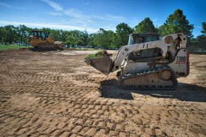 Crews level the ground in preparation for the new tennis courts at Stoneleigh Golf and Country Club in Round Hill.