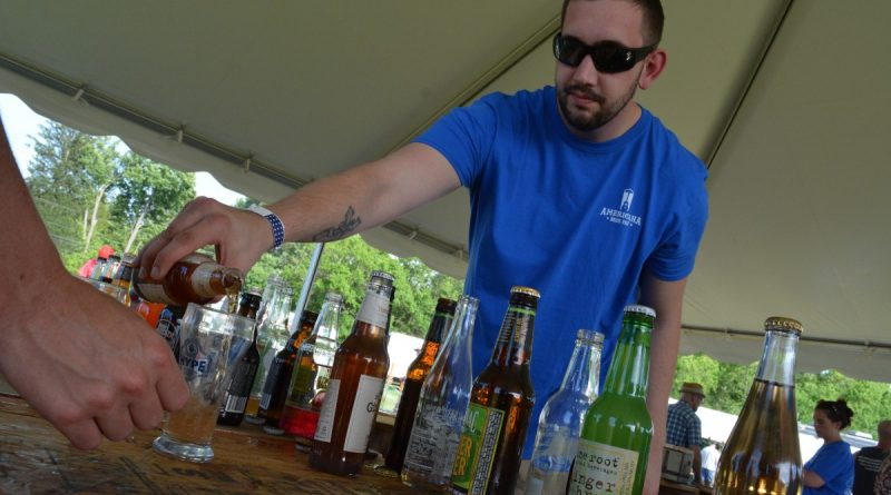 Serving up craft soda in the craft soda tent. (Renss Greene/Loudoun Now)