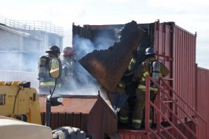 Firefighters train at the flashover simulator at the department's training center in Leesburg. This exercise teaches firefighters about the conditions before flashover—the moment that everything in a room reaches ignition temperature. (Loudoun County Department of Fire, Rescue and Emergency Management)
