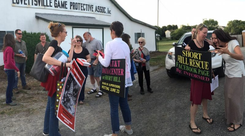 People opposed to the Short Hill project hold an impromptu meeting in the parking lot of the Lovettsville game club after a town council meeting with county staff was cancelled. (Courtesy of Sage Chandler)