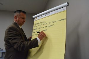 Community Planning Program Manager Christopher Garcia, the staff liaison to the stakeholders committee, takes notes at Monday's meeting. (Renss Greene/Loudoun Now)