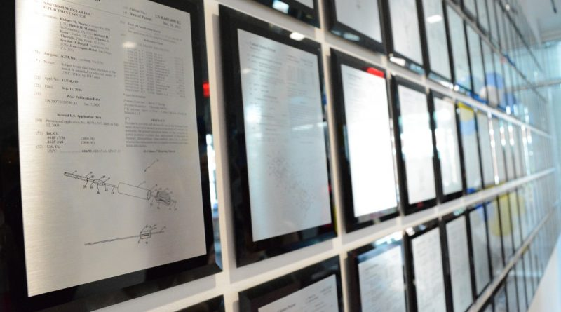 A wall of patents held by K2M in the company's new headquarters. (Renss Greene/Loudoun Now)