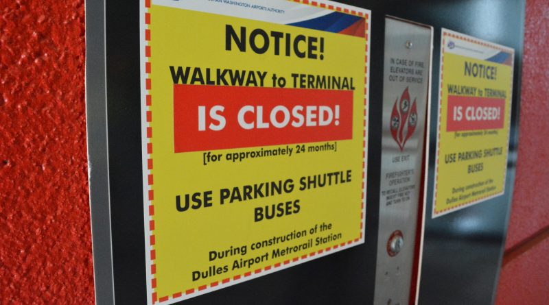 The underground walkway to the Dulles Airport terminal is closed while a new multi-story Metro station is built beside and above it.  [Renss Greene/Loudoun Now]