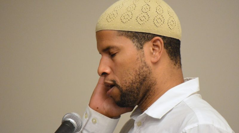 ADAMS Youth Coordinator Joshua Salaam leads a Muslim call to prayer. (Renss Greene/Loudoun Now)