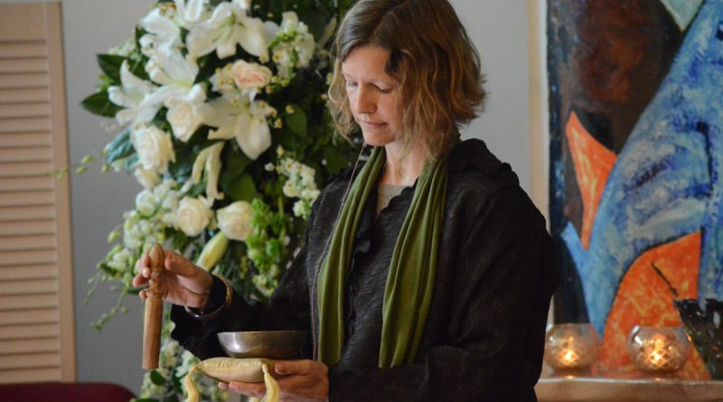 Unitarian Universalist Congregation of Sterling Reverend Anya Sammler-Michael rings a bowl 50 times to remember the people slain in Orlando. (Renss Greene/Loudoun Now)