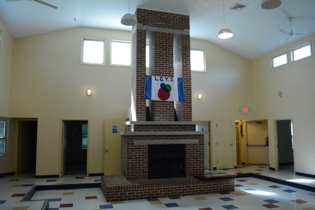 One of the old youth shelter's most distinguishing features, its fireplace and sunken living area, are not up to modern code and will be removed. (Renss Greene/Loudoun Now)