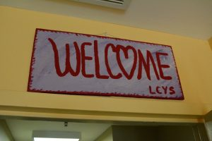 A sign by the front entrance welcomes youth staying at the older of the county's two youth shelters. (Renss Greene/Loudoun Now)