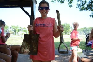 "Rising sixth grader Emerson Ray said she was ""too weak and too small"" to work with the shovel—until she broke it only a few minutes into the day's work. (Renss Greene/Loudoun Now)"