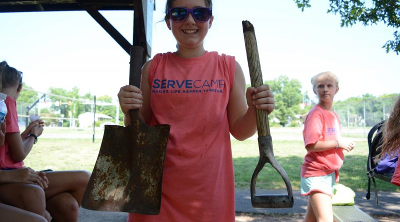 """Rising sixth grader Emerson Ray said she was """"too weak and too small"""" to work with the shovel—until she broke it only a few minutes into the day's work. (Renss Greene/Loudoun Now)"""