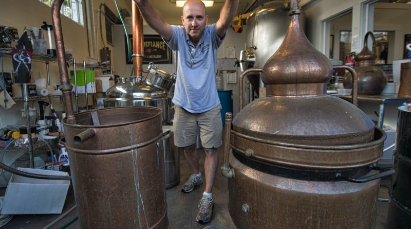 Distiller Peter Ahlf prepares to make absinthe using an old cooper alembic still at Mt. Defiance Cidery & Distillery in Middleburg, which has become a destination for the anise-flavored spirit. (Douglas Graham/Loudoun Now)