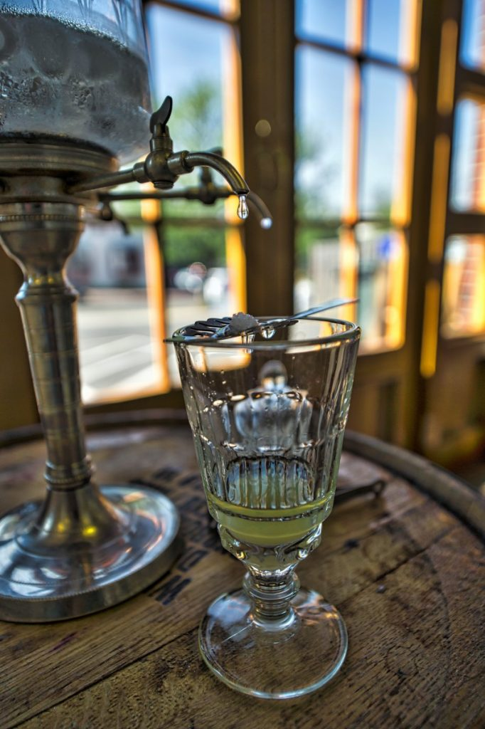 In Mt. Defiance Cidery & Distillery's showroom, cold water is dripped over a cube of sugar and into the absinthe, part of the so-called classic French Absinthe Ritual. (Douglas Graham/Loudoun Now)