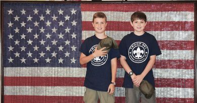 Two Boy Scouts take a moment to pose for a photo at last year's Hillsboro's Independence Day event. The town's annual celebration has been a tradition for more 30 years—but rarely happens on July 4.  [Photo by Amie Ware]
