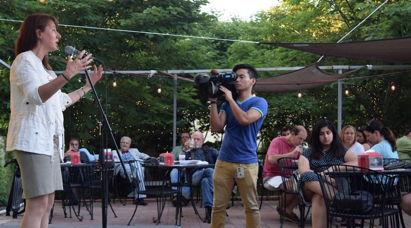 Trump campaign representative Juli Haller is filmed by a Japanese television news crew during a July 6 rally at The Cajun Experience in Leesburg.