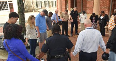 One day after three police officers were killed in Baton Rouge, LA, a small group of faith and political leaders gathered in Leesburg's town green this evening to join in a prayer of support for law enforcement.