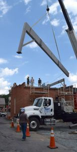 Crews maneuver steel beams into place atop the former BB&T Bank building on West Market Street in Leesburg. Later this year it will be space for rooftop dining.