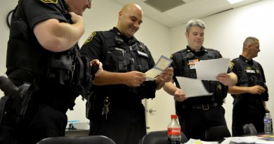Loudoun County Sheriff's Office deputies read thank-you notes from local families. (Danielle Nadler/Loudoun Now)
