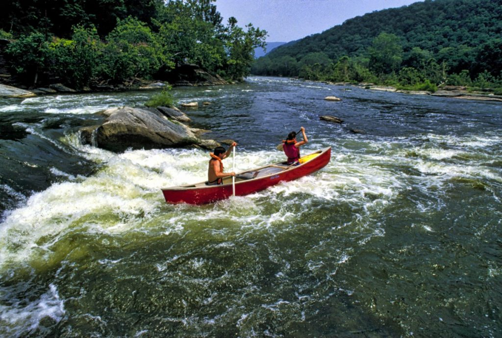 Braving the rushing waters of the Potomac River offers a challenge to canoeists launching from the Harpers Ferry Adventure Center. (Douglas Graham/Loudoun Now)