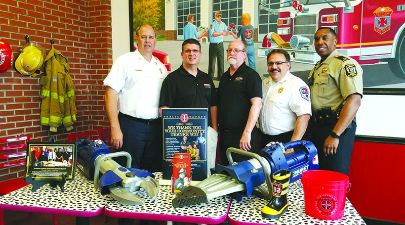 From left, Chief Bryan Andrews, Firehouse Subs area representative Dan Lowe, Firehouse Subs franchisee Marc Engelking, Sterling Rescue Vice President Stephen Grant, and Capt. Greg Brown, of the Loudoun County Sheriff's Office.  [Courtesy of Firehouse Subs]