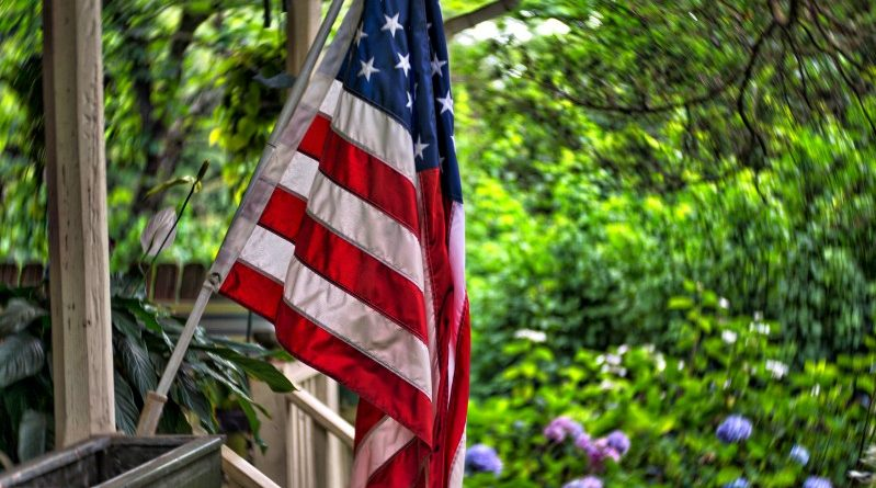 An American flag is displayed on a porch in Bluemont. (Douglas Graham/Loudoun Now)
