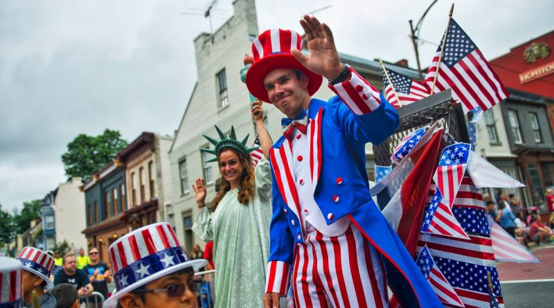 Lady Liberty and Uncle Sam march in the Independence Day Parade. (Douglas Graham/Loudoun Now)