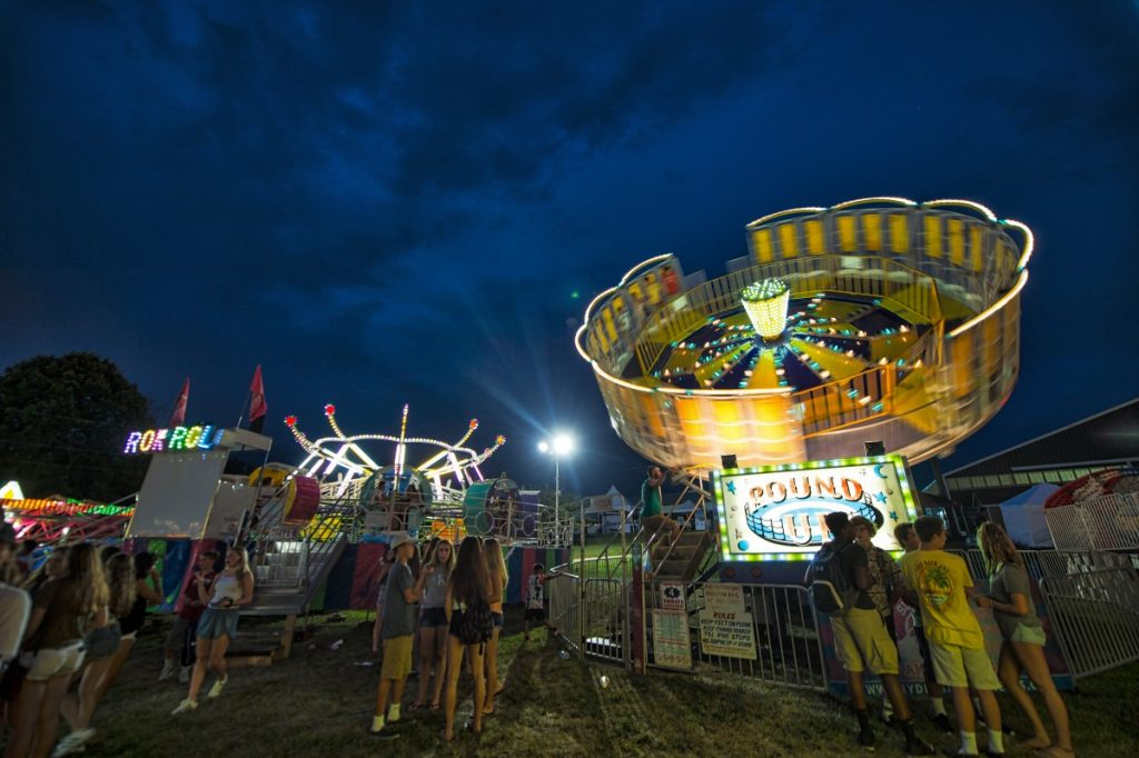 A right of passage with teenagers hanging out at the midway at the Loudoun County Fair. (Douglas Graham/Loudoun Now)