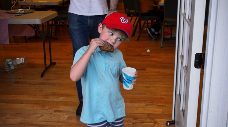 A boy gets his fill at the Waterford Citizens Association community potluck dinner. (Douglas Graham/Loudoun Now)