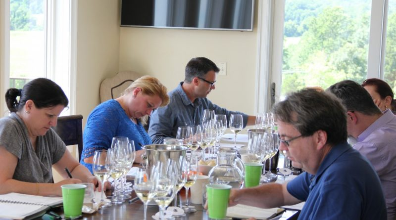 Six professionals from the wine and food industry spent Sunday evaluating 100 wines as part of the Loudoun Wineries Association's annual wine awards competition. (Aimee Henkle/LWA Wine Awards Committee)