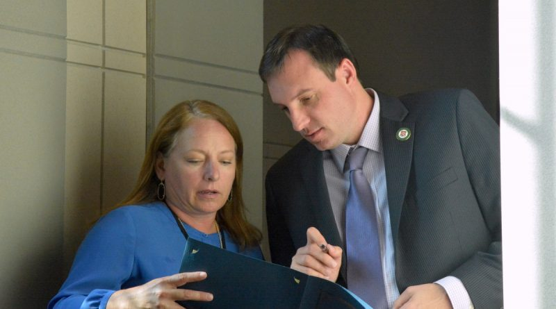 Supervisor Matthew F. Letourneau (R-Dulles) confers with his one of his staff aides, Monica Filyaw. (Renss Greene/Loudoun Now)