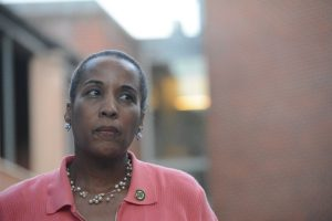County Chairwoman Phyllis J. Randall (D-At Large) pauses between reading names of seven people slain in the last several days. (Renss Greene/Loudoun Now)