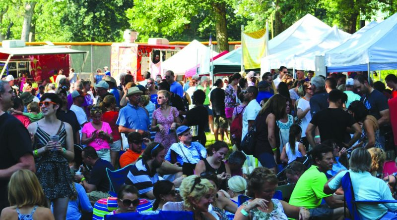 Festival goers enjoy the shade of Dillon Woods as they meet friends and sample the various wine and food tastings during last year's Purcellville's Wine & Food Festival.  [Town of Purcellville photo]