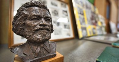 A bust of Fredrick Douglass sits on a table of old photos during the Douglass High School's 75th anniversary celebration on Saturday, Aug. 13. The school is a testament to the tenacity of Loudoun's rich black history. The black community of Loudoun showed un-paralleled strength of character during the desegregation era to get the school built so that their children could obtain an education. (Douglas Graham/Loudoun Now)