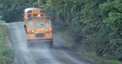 School buses navigate gravel roads in western Loudoun on the first day of school Monday. [Douglas Graham/Loudoun Now]