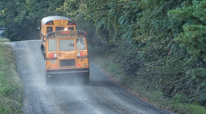 School buses navigate gravel roads in western Loudoun on the first day of school. [Douglas Graham/Loudoun Now]