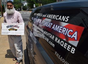 Akhtar Raqeeb has been driving a taxi in Northern Virginia for 16 years and says he is disappointed by the bitter political discourse in his adopted nation. He wants to help change that. [Norman K. Styer/Loudoun Now]