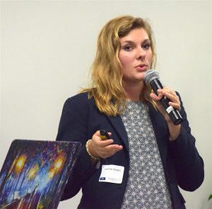 Stone Bridge High School senior Maddie Feigles explains the inner workings of the IdentID platform, designed to tag airport workers who represent the greatest security threat.