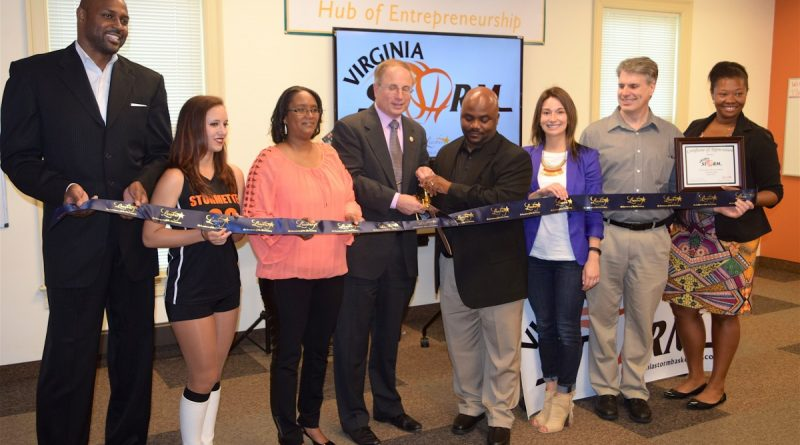 Leesburg Mayor Dave Butler, center, officiates a ribbon-cutting ceremony for the Virginia Storm.